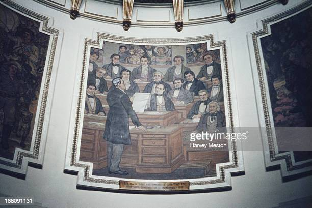 A painting held inside the Alabama State Capitol building titled 'Governor William Wyatt Bibb and Committee Drafting the First State Constitution at...