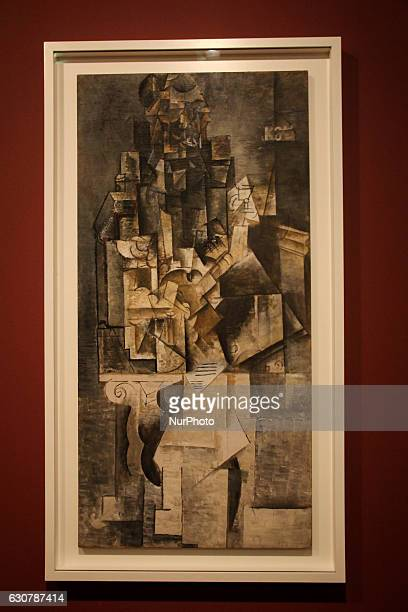 Painting Homme à la guitare by Pablo Picasso during Pablo Picasso exhibition held in Rio de Janeiro File image produced on October 14 2016 in Rio de...