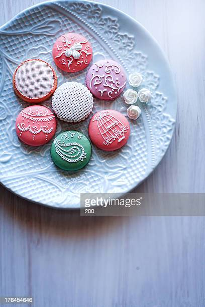 Painting icing on macarons