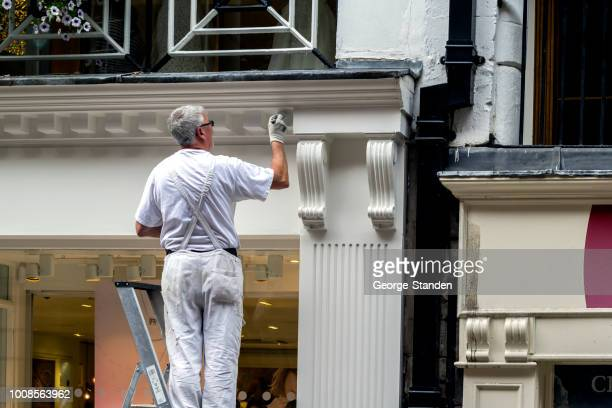 painting in chester. - facade stock pictures, royalty-free photos & images