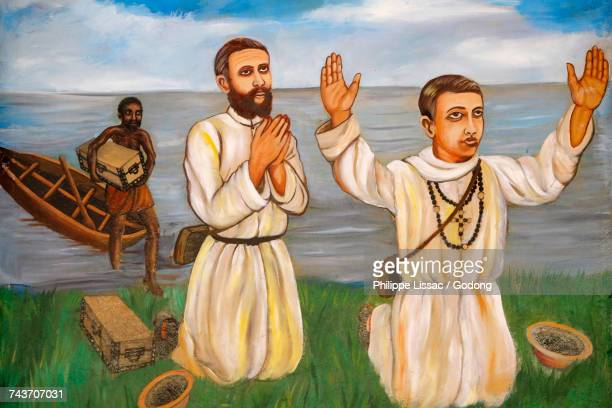 painting in namugongo catholic martyrs shrine church, kampala. arrival of missionaries on the shore of victoria lake. uganda. - martyrs of uganda catholic church stock pictures, royalty-free photos & images