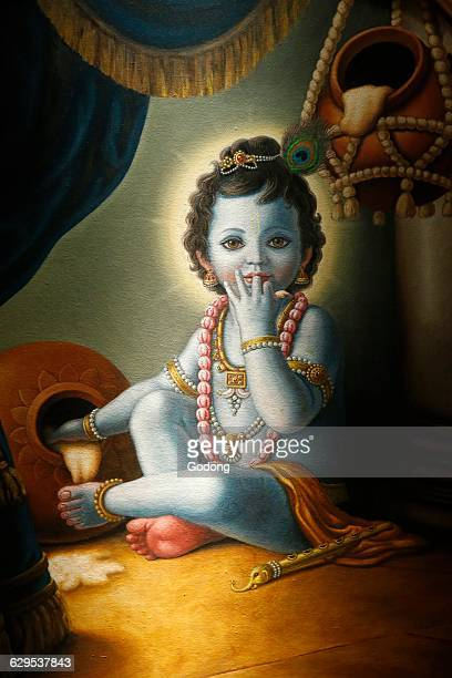 Painting in the London ISKCON hindu temple Baby Krishna spilling butter