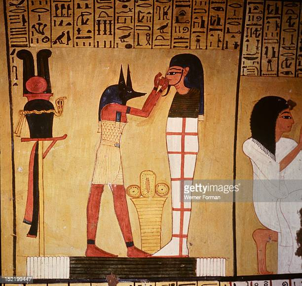 A painting in the tomb of Inherkha A priest wearing the mask of Anubis god of mummification is proffering to the mummy a bowl of holy water The...