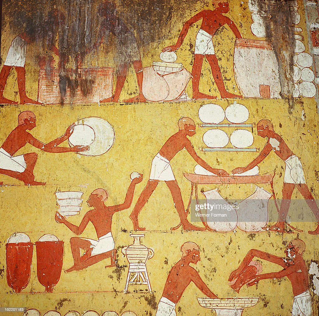 Painting in the tomb of Qenamun, West Thebes, Bakers mixing and kneading dough and filling bread moulds. Egypt. Ancient Egyptian. New Kingdom,18th Dynasty,1550 1295BC. Sheikh Abd el Qurna, West Thebes.