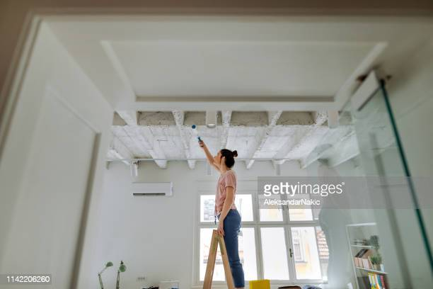 painting interior of future creative, business studio - ceiling stock pictures, royalty-free photos & images