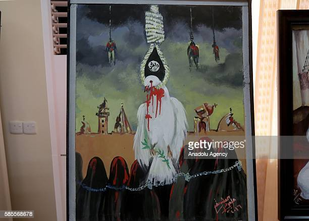 Painting is seen at an exhibition, which describes the Daesh Sinjar massacre, as part of an event held for 2nd anniversary of Daesh massacre on...