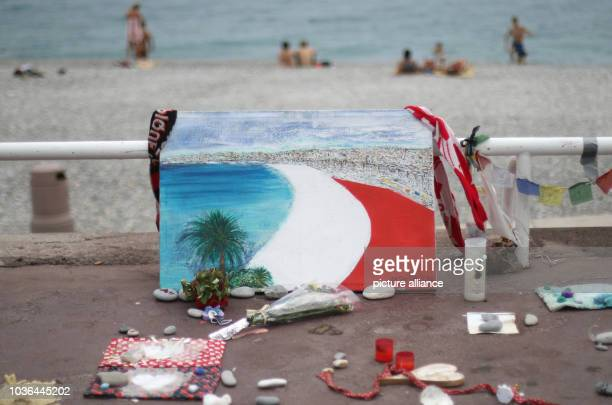 A painting of a beach painted in the French colours can be seen on the 'Promenade des Anglais' in Nice France 14 September 2016 A 31yearold Tunisian...