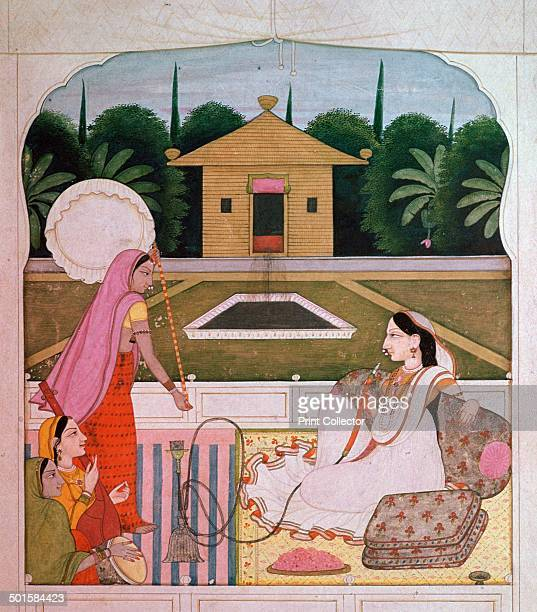Painting of a princess with a huqqa listening to female musicians in a palace garden from Guler in the Punjab from the VA's collection