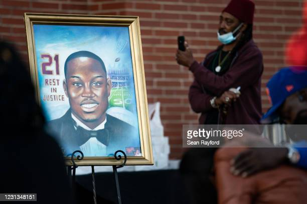 Painting of Ahmaud Arbery is displayed during a vigil at New Springfield Baptist Church on February 23, 2021 in Waynesboro, Georgia. Arbery, a Black...