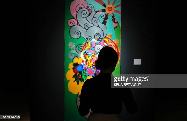 A Painting of Artist Beatriz Milhazes is on displayd before a Latin American Art auction at Christies on May 24 2017 in New York / AFP PHOTO / Kena...