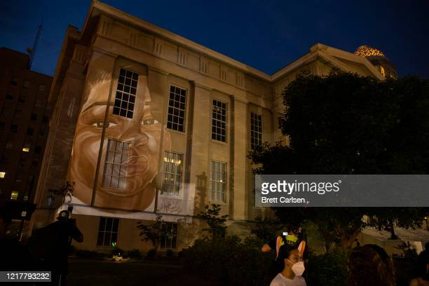Painting of Breonna Taylor is projected onto a government building during a peaceful protest on June 5, 2020 in Louisville, Kentucky. Protests across...