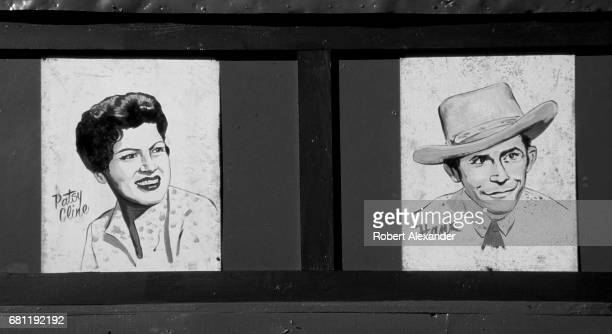 Painting of country music singers Patsy Cline and Hank Williams Sr are mounted on the wall above the entrance to Tootsie's Orchid Lounge in Nashville...