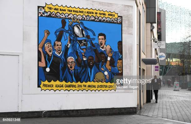 A painting of former Leicester City Manager Claudio Ranieri lifting the Premier League trophy is seen in the city centre prior to the Premier League...
