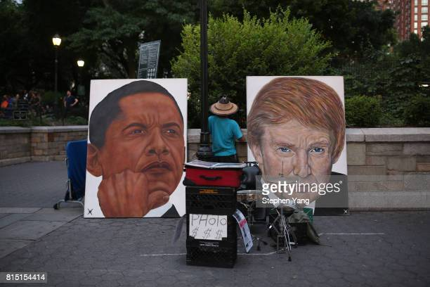 A painting of former US president Barack Obama left and current US president Donald Trump right is seen in New York City