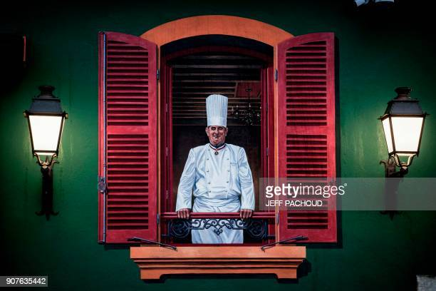 A painting of French chef Paul Bocuse is pictured in Bocuse's restaurant 'L'auberge du Pont de Collonges' on January 20 2018 in CollongesauMontd'Or...