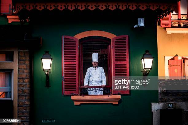 TOPSHOT A painting of French chef Paul Bocuse is pictured in Bocuse's restaurant 'L'auberge du Pont de Collonges' on January 20 2018 in...