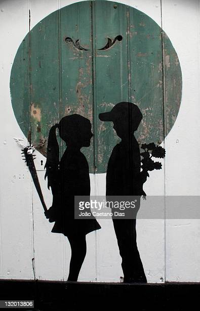 Painting of girl and boy on door