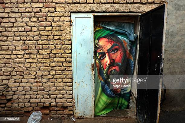 Painting of Imam Hussein on a curtain installed in front of the door where the annual religious performance of Taazieh is held November 13 2013 in...