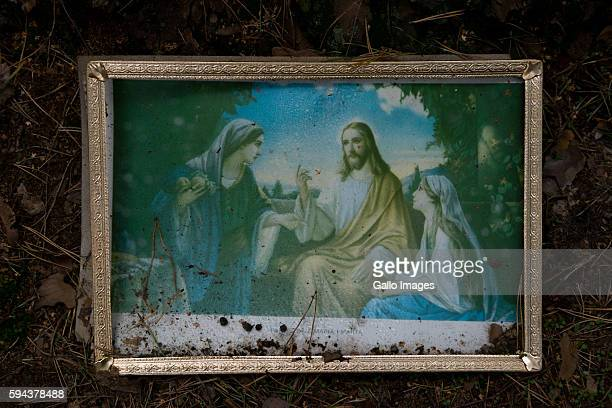 Painting of Jesus Mary and Martha lies on the ground on the Holy Hill of Grabarka on August 18 2016 in Grabarka Poland It is said that a great...
