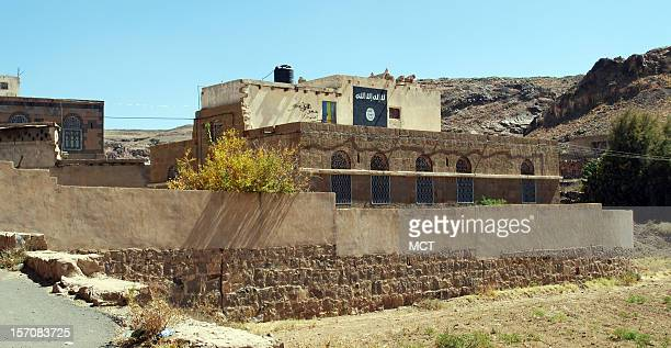 A painting of the black flag brandished by Al Qaida in the Arabian Peninsula marks the wall of Adnan al Qadhi's house which sits in the shadow of the...