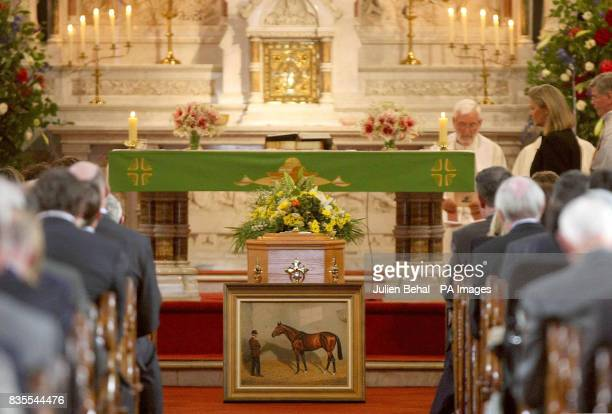A painting of the horse Nijinsky lays in front of the coffin of Vincent O'Brien during his funeral at StConleth's Church Newbridge County Kildare