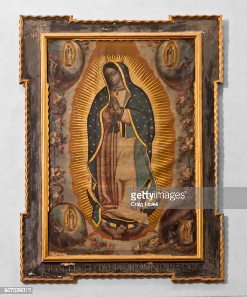 a painting of the virgin of guadalupe in the san rafael church - san miguel de allende, mexico - virgen de guadalupe fotografías e imágenes de stock