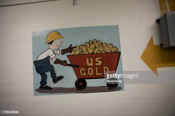 A painting of US Gold is displayed on a wall at the United States Mint at West Point in West Point New York US on Wednesday June 5 2013 Sales of gold...