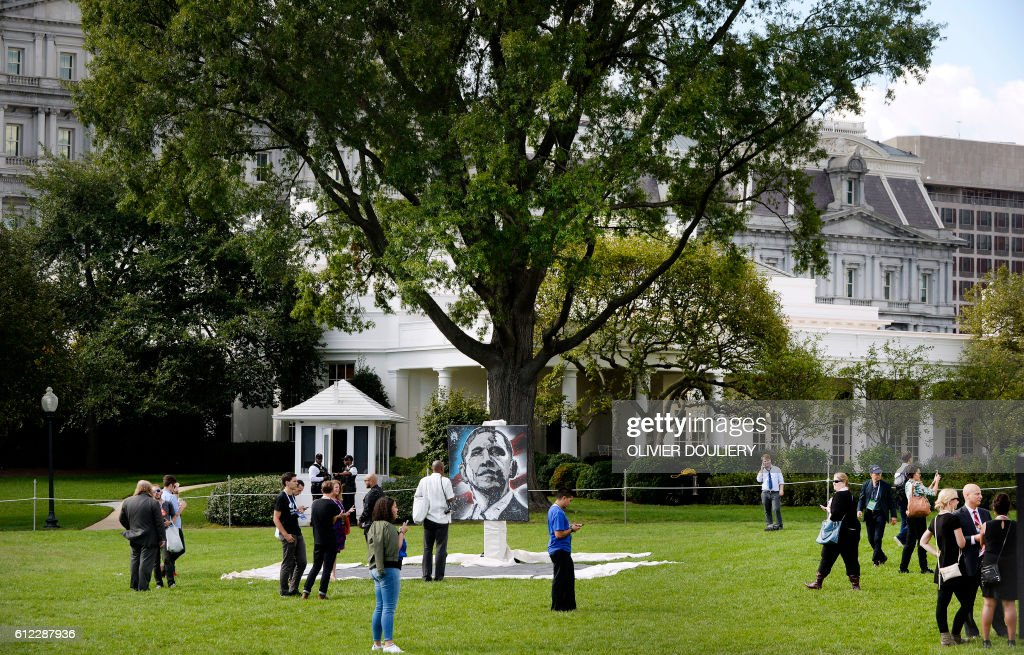 A painting of US President Barack Obama is on display at the first South by South Lawn event, a festival of ideas, art, and action on the South Lawn of the White House in Washington, DC on October 3, 2016. / AFP PHOTO / Olivier Douliery