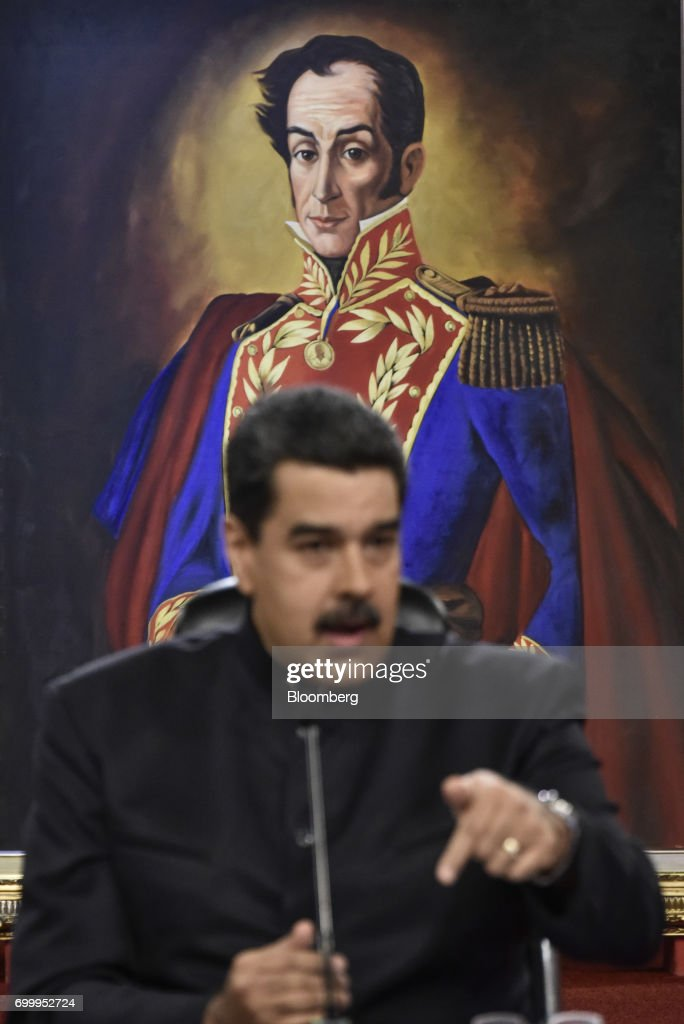 A painting of Venezuelan political leader Simon Bolivar is displayed behind Nicolas Maduro, president of Venezuela, during a press conference in Caracas, Venezuela, on Thursday, June 22, 2017. Since June 15, Maduro has named four new ministers: Mirelys Contreras as Prisons Minister; Ana Reyes as Culture Minister; Kyra Andrade as Communes Minister; Yamilet Mirabal Calderon as Indigenous Peoples Minister; and Samuel Moncada as foreign minister. Photographer: Carlos Becerra/Bloomberg via Getty Images