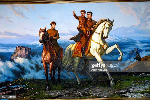 Painting on display at SEK animation studios depicting Kim Jongil as a child in the arms of his father Kim ilSung on a white stallion Behind the duo...