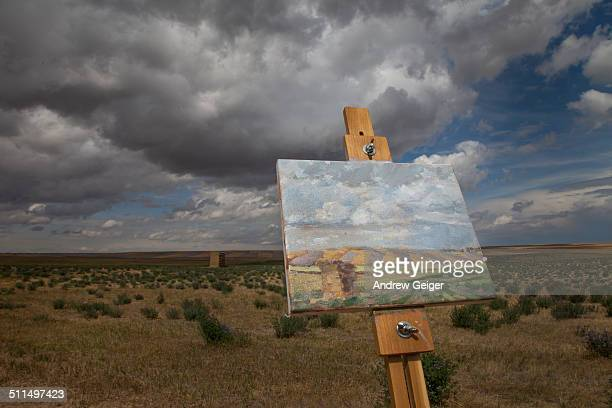 Painting on easel that matches actual landscape