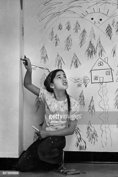Painting on the Walls with Immunity Wendy Brown is helping decorate childcare center She's a daughter of Lynn Brown member of Colorado Commission on...