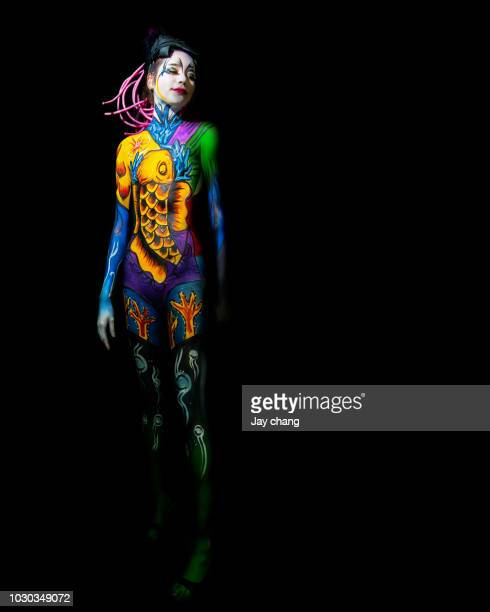 painting - body paint stock pictures, royalty-free photos & images