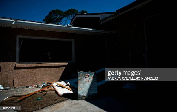A painting rests in front of a damaged home in Port St Joe Florida on October 13 three days after hurricane Michael hit the area Since Hurricane...