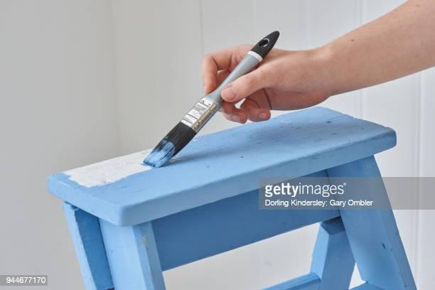 painting step ladder blue.