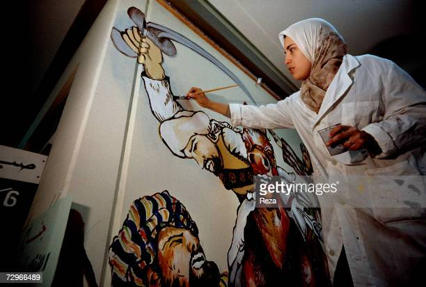 A painting teacher paints on a wall at the Altakadum school on March 2000 in Tripoli Libya