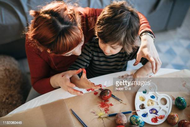 painting the eggs together - dirty easter stock pictures, royalty-free photos & images