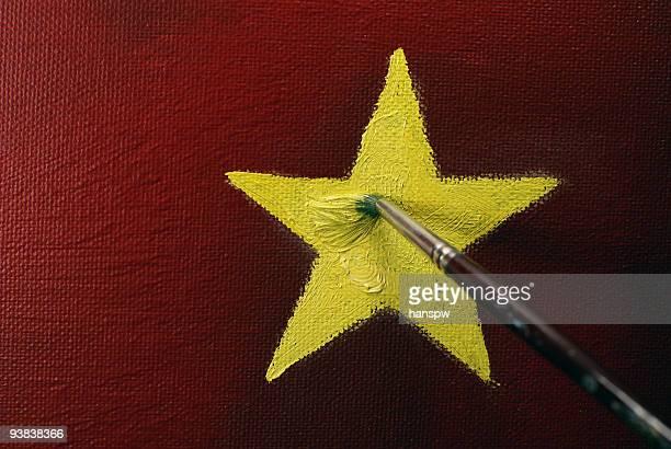 dipingere la star - bandiera comunista foto e immagini stock