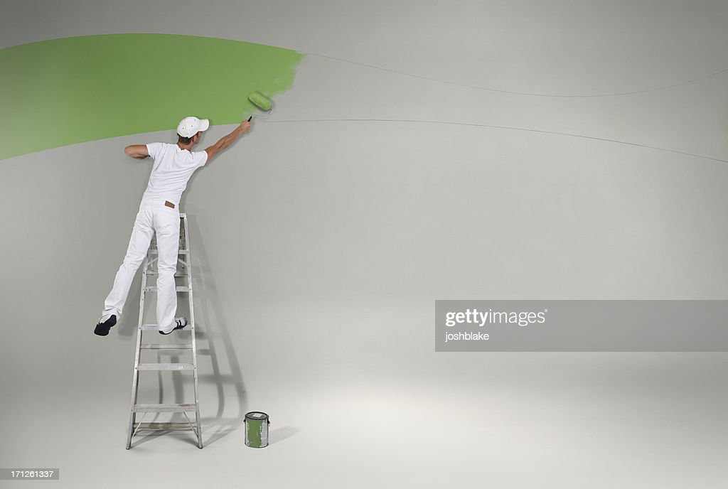 Painting the wall green again : Stock Photo