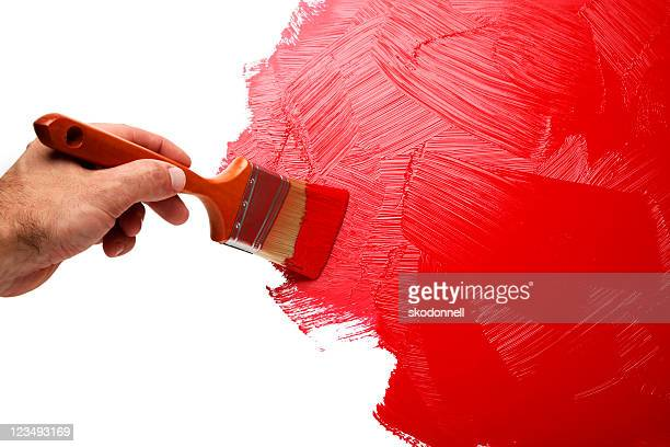painting the wall with red paint