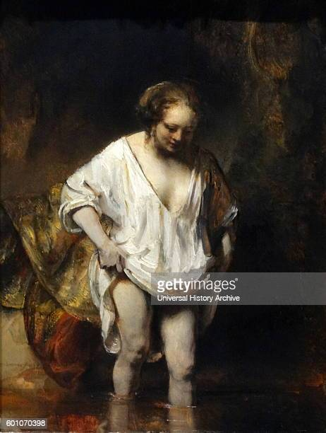 Painting titled 'A Woman bathing in a Stream' by Rembrandt Harmenszoon van Rijn a Dutch painter and etcher Dated 17th Century