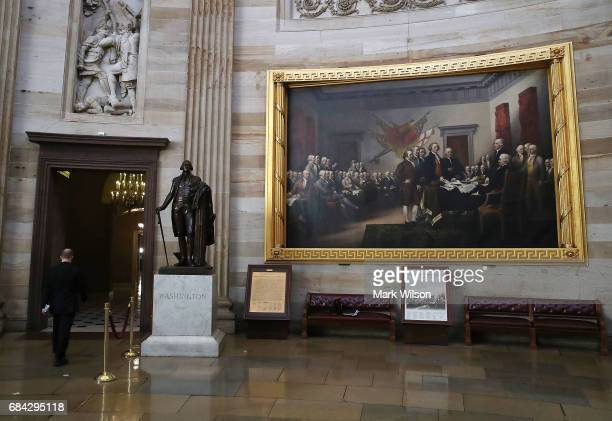 A painting titled Declaration of Independence hangs on the wall inside the US Capitol on May 17 2017 in Washington DC Today the Justice Department...
