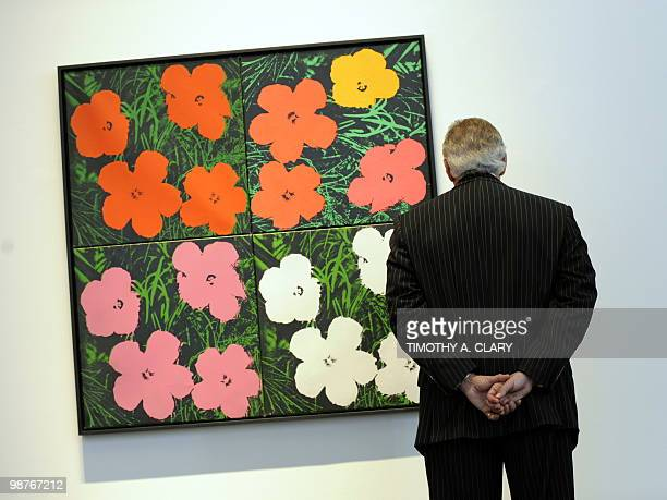 A painting titled 'Flowers' by Andy Warhol during a press preview April 30 2010 at Sotheby's New York for their spring sales of Impressionist and...