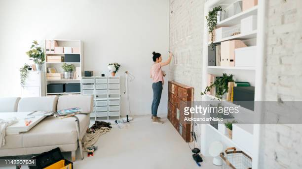 painting walls of new apartment - whitewashed stock photos and pictures