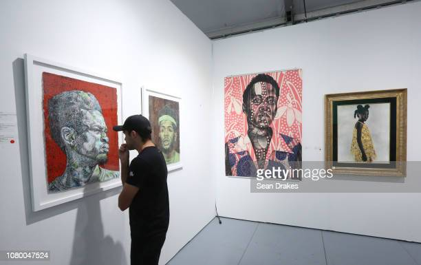 Paintings by Aflred Conteh mixed media artwork by Delita Martin and Tawny Chatmon presented by Galerie Myrtis Fine Arts of Baltimore at Scope Art...