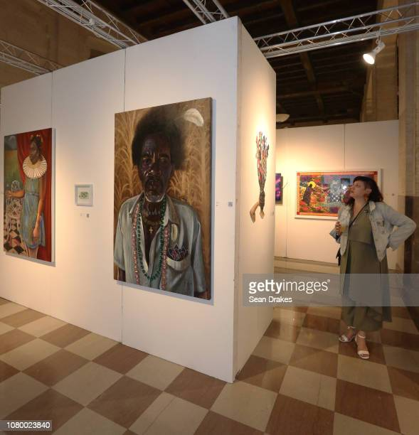 Paintings by Jamaican artist Alicia Brown on exhibit at the 2018 PRIZM Art Fair in the Alfred I DuPont Building as part of Art Basel Miami Beach on...