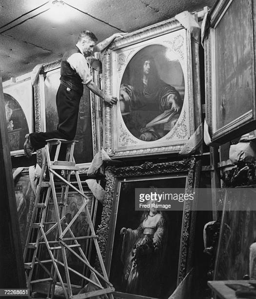 Paintings from the National Gallery undergo their daily dusting in a subterranean chamber at Manod Quarry north Wales September 1942 The gallery's...
