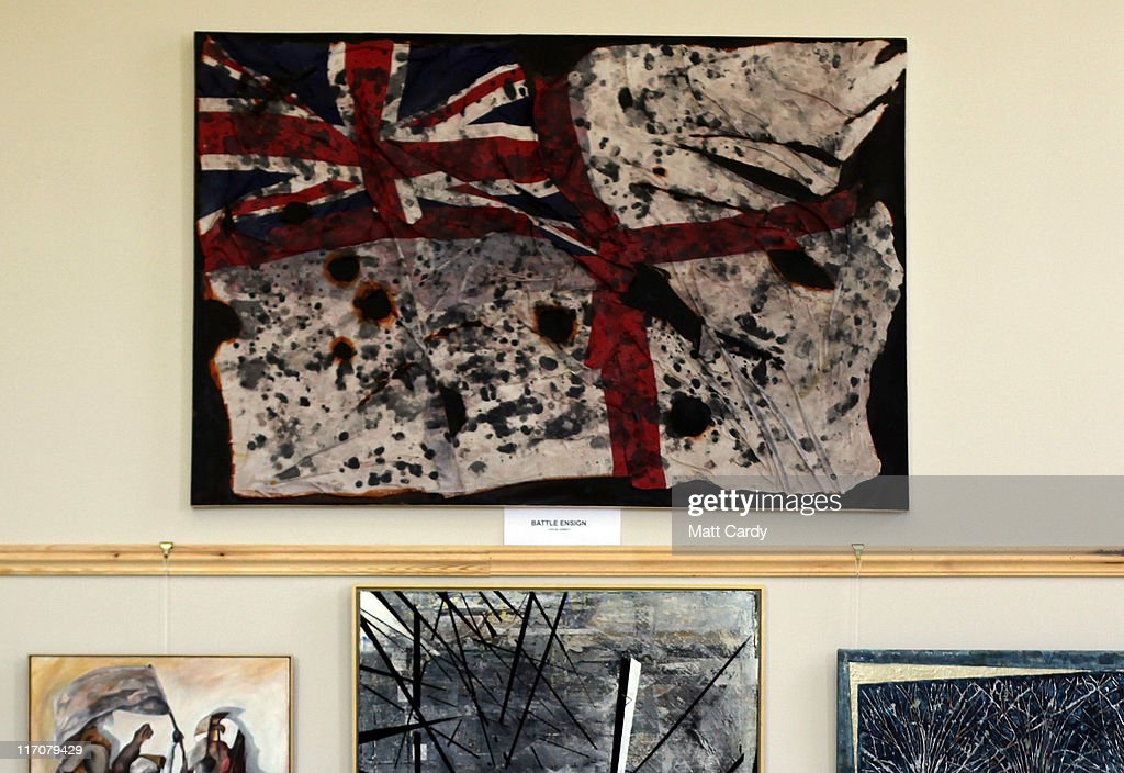 Paintings including (top) Battle Ensign by ex-Royal Navy gunner, John Mc Dermott are displayed inside Exeter Castle on June 21, 2011 in Exeter, England. The paintings are among artworks produced by former and current servicemen and women currently being exhibited at Exeter Castle. The free exhibition, Entrance to War Art, aims to foster understanding between Post Traumatic Stress Disorder (PTSD) sufferers and the wider community and runs until Sunday.