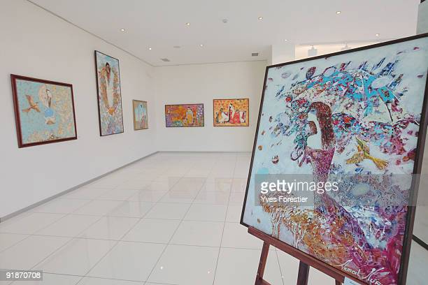 Paintings of artist Akmal Nur are displayed at the Center of National Arts on October 13 2009 in Tashkent Uzbekistan