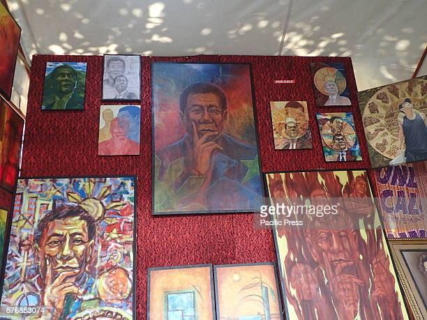 Paintings of different faces of newly elected Philippine President Rodrigo Duterte were showcased and sold during the 50th founding anniversary of...